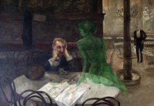 アブサンを飲む男の画像